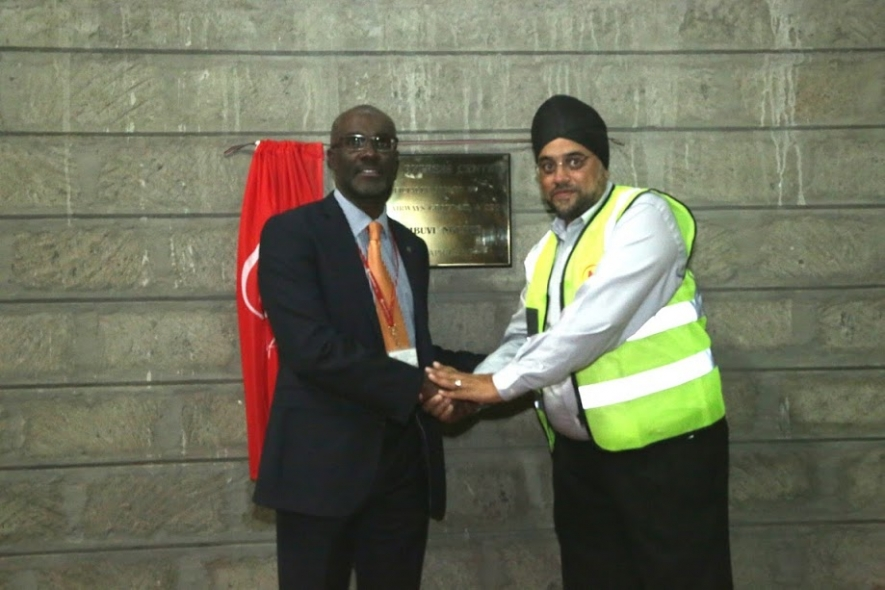 Kenya Airways CEO and MD, Mbuvi Ngunze is congratulated by a customer during the launch of the new Cargo Express Centre at JKIA