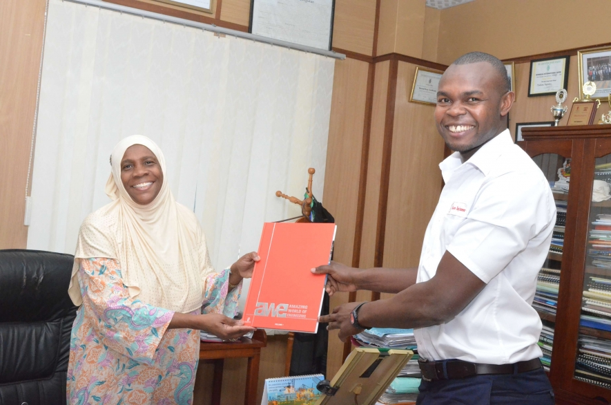 IPL CEO, Booker Ngesa(Left) hands over Amazing World of Engineers coffee table book to TUM VC,Prof.Laila Abubakar in Mombasa