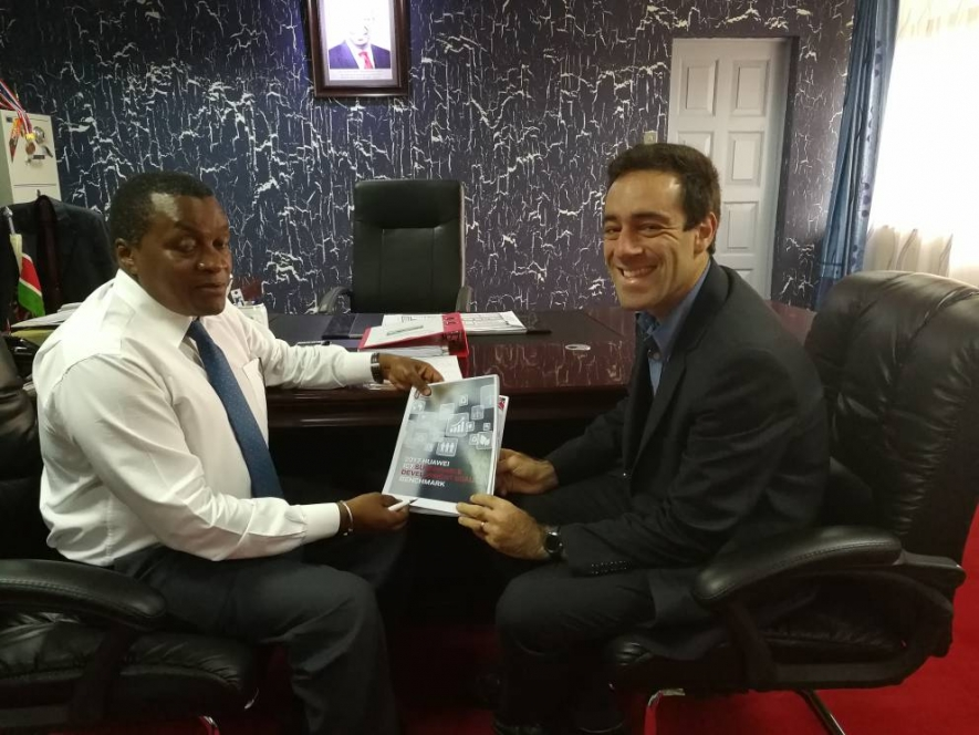 The Principal Secretary for ICT Eng. Victor Kyalo receiving a copy of the 2017 Huawei ICT SDG Report from Adam Lane, Senior Director, Public Affairs Huawei Southern Africa