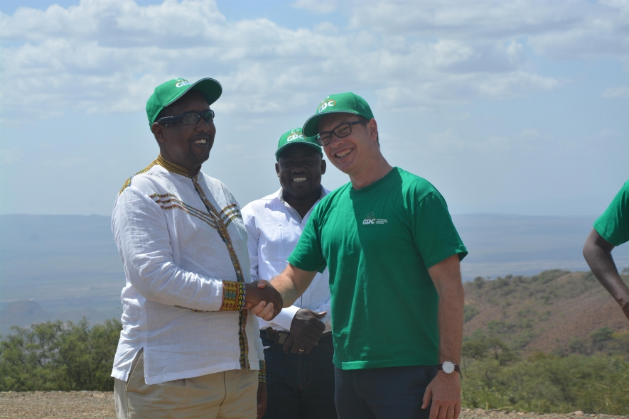GDC MD & CEO Eng. Johnson P. Ole Nchoe shakes with KfW Country Director Dr. Klaus Liebig during the site visit at the Paka Geothermal Project. Looking on is GDC director Mr. Namada Simoni. KfW is a financier of the North Rift project.