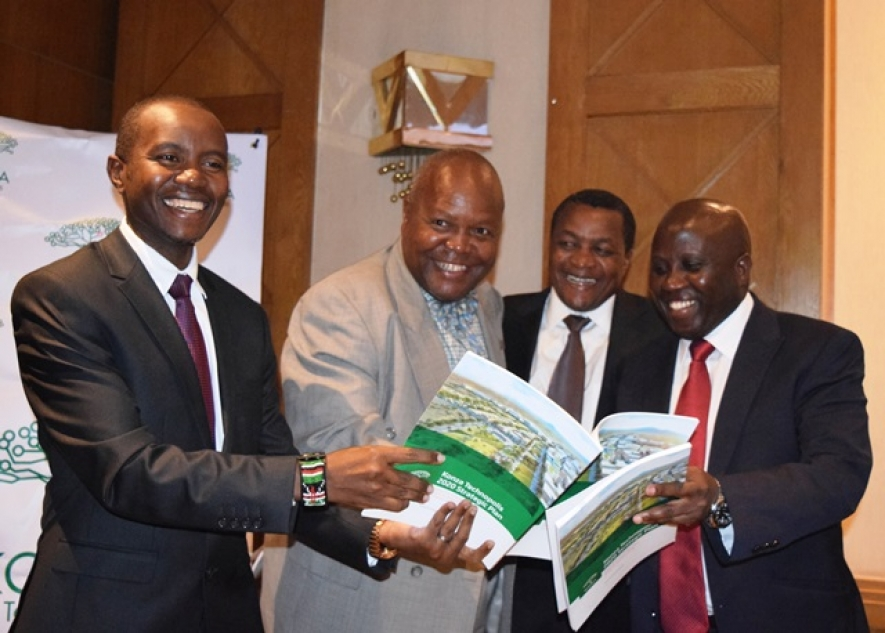 From left is Cabinet Secretary for ICT Joe Mucheru, (KoTDA) Chairman Dr Reuben Mutiso, Principal Secretary for ICT and Innovation Victor Kyalo and the CEO KoTDA Eng. John Tanui admires a copy of Konza Technopolis Strategic Plan (2016-2020) during its launch at Hotel Intercontinental recently.