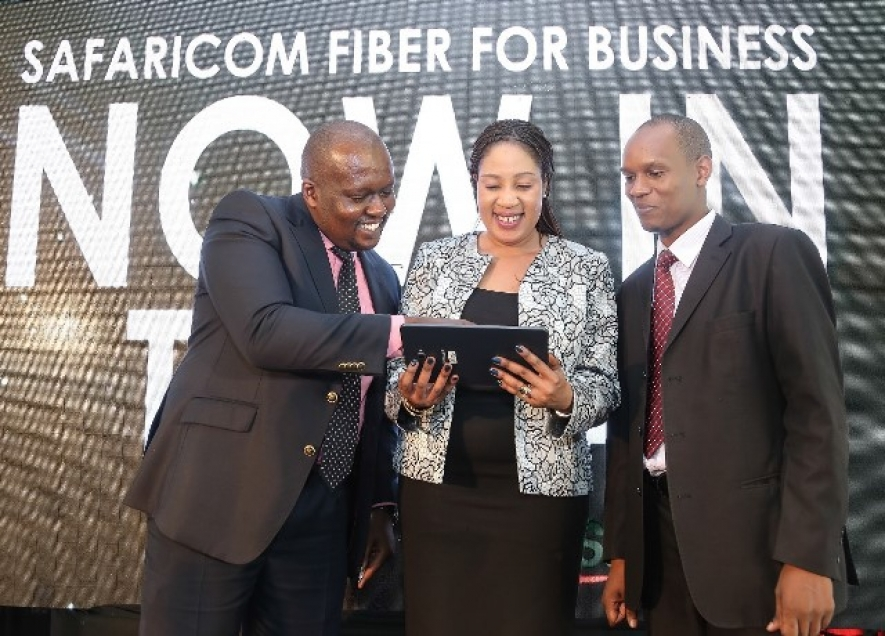 Safaricom Director Enterprise Business Unit, Rita Okuthe engages Daniel Gachao (left) and Isaack Murimi during the official launch of Safaricom Fiber for Business in Thika.