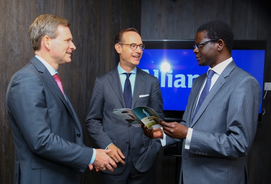 (L-R) Coenraad Vrolijk Regional CEO Africa Allianz and Oliver Baete, Chairman of the Board of Management of Allianz SE engage with Demba Sy, CEO Allianz Insurance Co. of Kenya Ltd during the Chairman's visit to the Allianz Kenya offices.