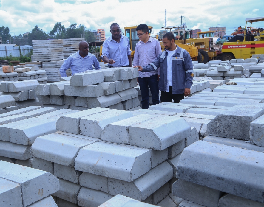 Savannah Cement Marketing Manager, Mr Joseph Mugambi (left) flanked by Managing Director, Mr. Ronald Ndegwa (second left) and the firm's Corporate Sales Advisor, Mr. Zubesh Yoon (right) join Sinohydro Tianjin Engineering Materials Engineer, Mr Liu Yuanli (second right) in inspecting concrete products at the Sinohydro Tianjin Engineering company depot along Outer Ring road. Savannah Cement is the flagship cement products supplier on the Kshs 8.5billion dual carriage road construction project.